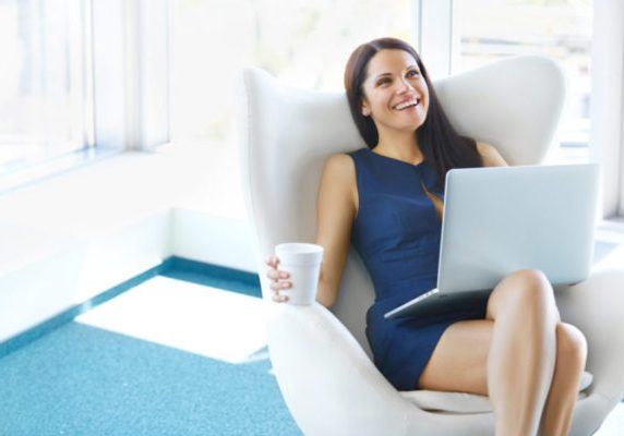 Portrait of relaxed business woman in office. Relax and freedom concept