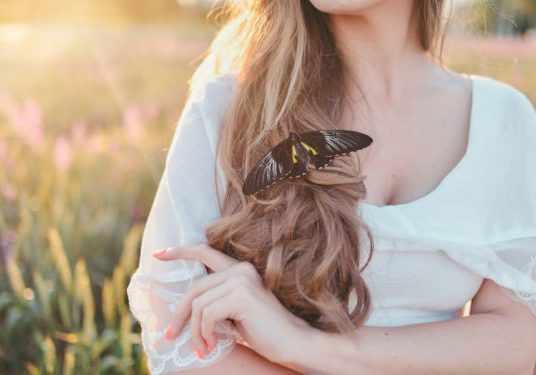 girl with long hair and big, beautiful butterfly